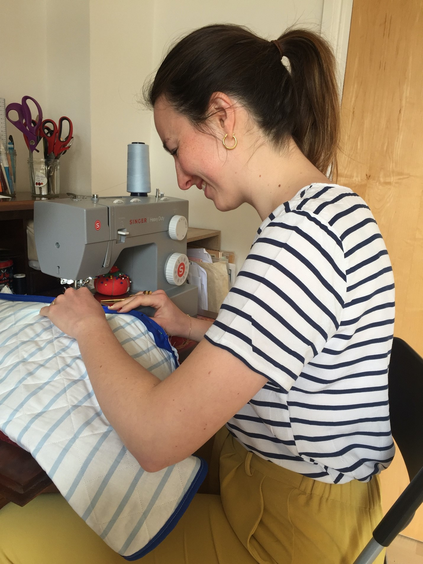 Marion Perrin working on her sewing machine