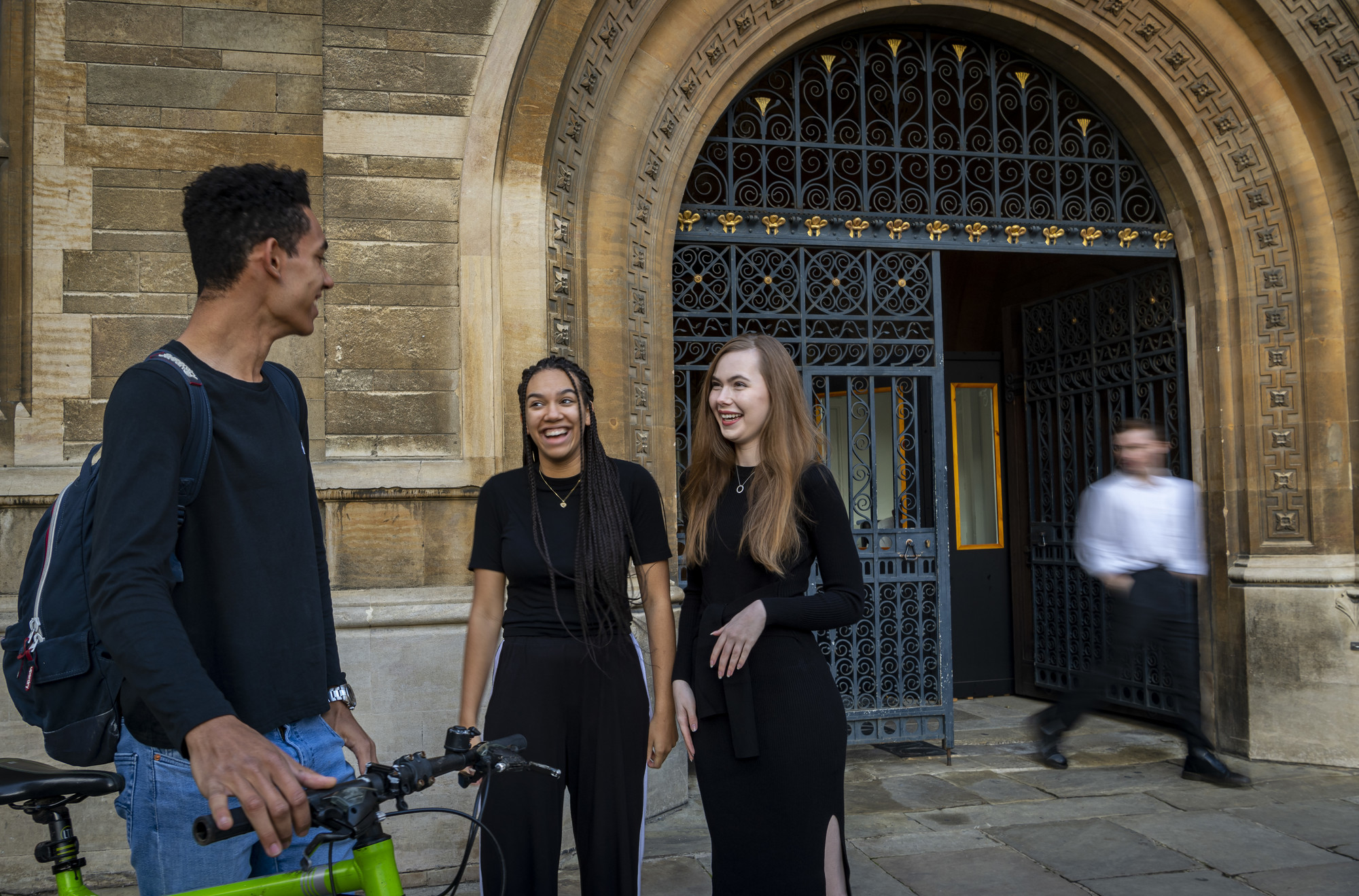 Students talking outside the Great Gate