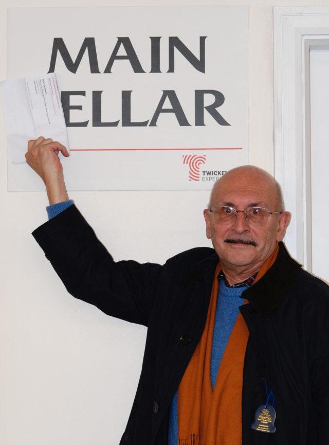 David Ellar in front of a sign saying 'Main Ellar'