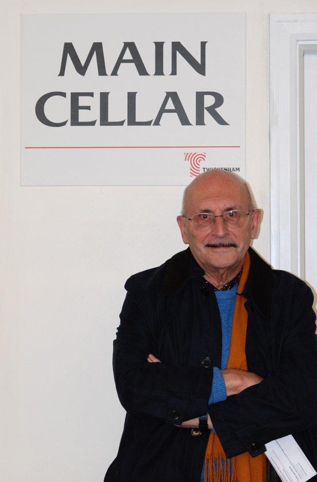 David Ellar in front of a sign saying 'Main Cellar'