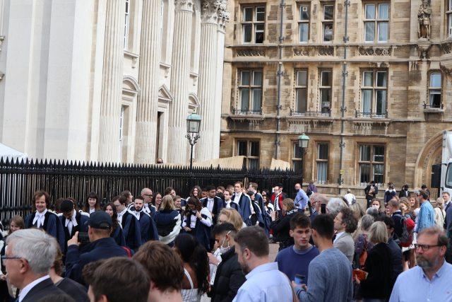 Crowds watching Caius graduands waiting to enter Senate House