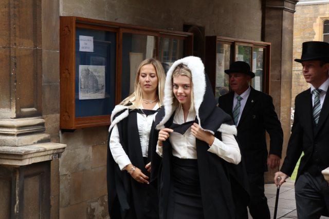 A female wearing a graduation hood